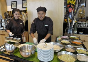 Chef Jumpa Promnok and Chef Darunee Loaarun preparing for the Thai Food Fest
